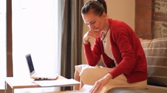 A young woman stressed because of bills - stock footage