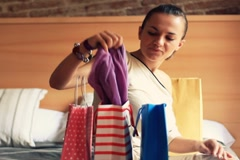 Beautiful woman trying on her purchases after shopping Stock Footage