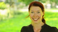Happy woman walking in a park Stock Footage