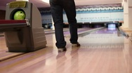 Stock Video Footage of Man throw ball and hit pins in bowling club