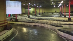 Carting race is in indoor place with video board Stock Footage