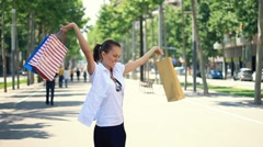 Woman with shopping bags turning around, steadicam shot, slow motion - stock footage
