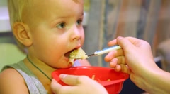 Mother feeding her lovely baby with dinner Stock Footage