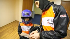 Father gives instructions to son before go-cart racing Stock Footage
