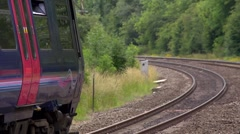 Local passenger train pulling away from a rural station in Oxfordshire - Detail Stock Footage