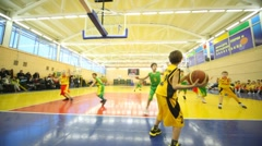 Boys play basketball in RSUPES&T - stock footage