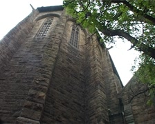 Low angle of St George's Cathedral in Cape Town - whip to tree, GFSD Stock Footage