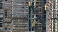 Construction site elevators at work, view from roof of another building Stock Footage