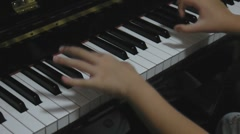 Hands playing piano - stock footage