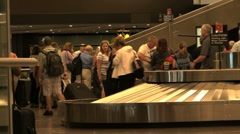 Picking up luggage - stock footage