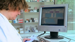 Stock Video Footage of Pharmacist sales medicines in pharmacies