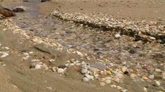 Clear water creek at beach - Water being wasted away Stock Footage