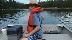 Boy piloting Boat Stock Footage