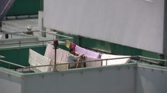 Doing laundry on rooftop in Shanghai (zoom) Stock Footage