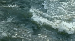 Сrossing streams of wild river - stock footage