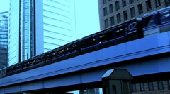 Riding the train with modern office buildings in the background. Stock Footage