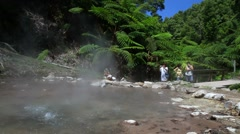Tourists at Caldeira Velha hot spring Stock Footage