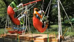 Happy girls on a swing in park Stock Footage