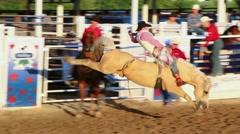 Cowboy riding bareback on a bucking horse Stock Footage