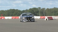Stock Video Footage of Ford Mustang on race track