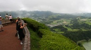 Stock Video Footage of Tourists viewing the Furnas valley, pan