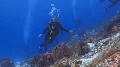 Female diver waving to camera Stock Footage