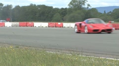 Ferrari Enzo and Mosler MT900 racing through chicane. Stock Footage