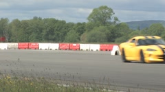 Yellow Dodge Viper on race track Stock Footage