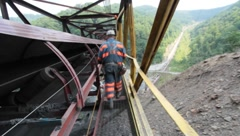 Coal Mine Employee on Bridge Above Ground (HD) c Stock Footage