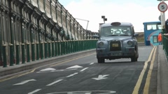 Traditional British Taxi Arrives At Edinburgh Waverley Train Station Scotland UK Stock Footage