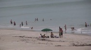 Stock Video Footage of people on the beach playing in the ocean