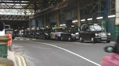 British Taxis Line Up For Passengers At Edinburgh Waverley Rail Station UK Stock Footage