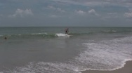 Stock Video Footage of Surfer wipes out on the ocean waves