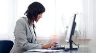 Overworked, tired and stressed businesswoman typing on computer Stock Footage