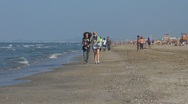 Stock Video Footage of People relaxing and walking on the sandy beach,  Rimini, Italy,