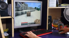 Playing Minecraft computer game Stock Footage