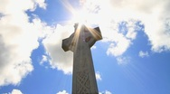 Stock Video Footage of Timelapse Celtic Cross with Clouds and Heavenly Sun GFTHD