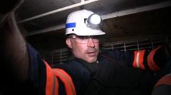 Coal Mine Employees on Mine Equipment (HD) c - stock footage