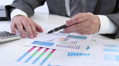 Examining business graph - stock footage