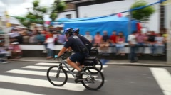 Policemen on bicycles Stock Footage