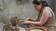 Woman making hand-thrown ceramics Stock Footage