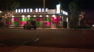 Corner Drugstore or Pharmacy at Night 1 Stock Footage
