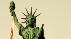 "Stock Footage-Statue of Liberty with American Flag - ""Warmish""  Stock Footage"