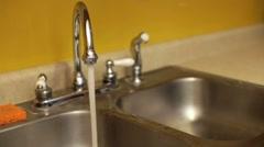 Kitchen Sink with running water slider shot Stock Footage