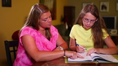 Mother Helps Daughter with Homework - stock footage