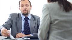Boss giving reprimand to female worker HD Stock Footage