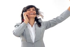 Exited businesswoman receiving great news on the phone, isolated on white NTSC Stock Footage