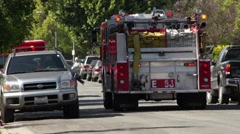 Fire Fighter Truck / Ambulance Leaving the Scene HD Stock Footage