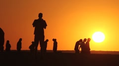 Sunset at the beach group Stock Footage