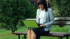 Businesswoman finishing work and relax on park bench, outdoors HD Stock Footage